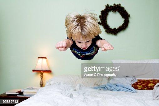Boy Levitates on Bed