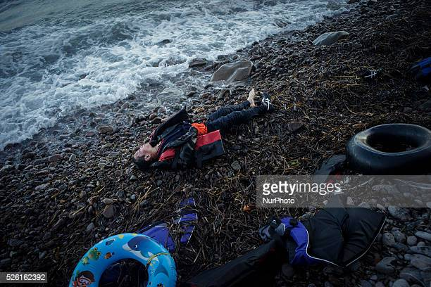 A boy lies dead on the shore of Skala Sikamineas after the sea washed him out Lesbos November 1 2015