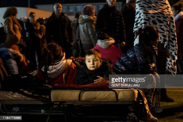 A boy lies in a portable bed in a camp at the soccer stadium in Durres on November 26 after the strongest earthquake in decades claimed at least 20...