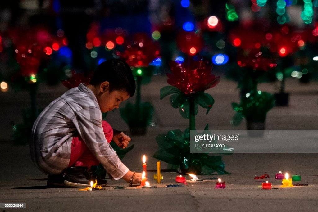 A boy lights candles on the Day of the Little Candles in Cali Colombia  sc 1 st  Getty Images & A boy lights candles on the Day of the Little Candles in Cali ... azcodes.com