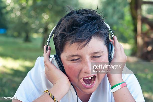 Boy listening to music and singing