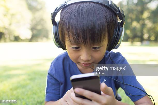 Boy listening to music on smart phone