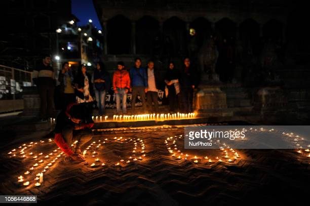 A boy lit a candle lights on the memory of Nirmala Panta in 100th day at the premises of Krishna Mandir Patan Nepal on Friday November 02 2018 Over...