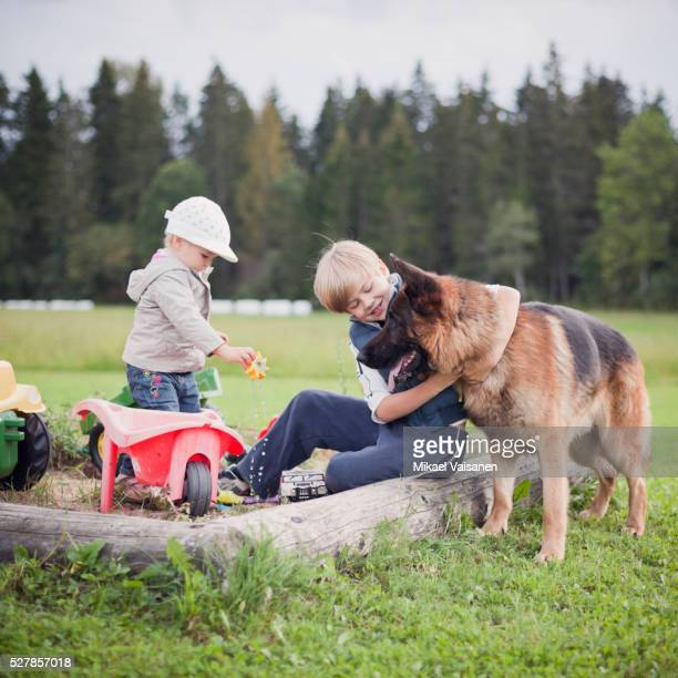 Boy (4-5), little sister (2-3) and dog