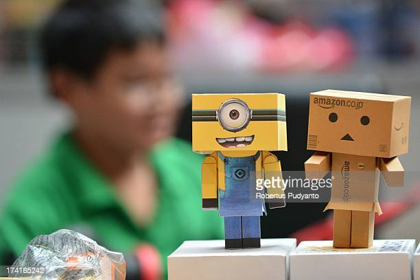 A boy look at Minion and Amazon robot box toys in Toys Fair and Cosplay Competition at Grand City Mall on July 21 2013 in Surabaya Indonesia...