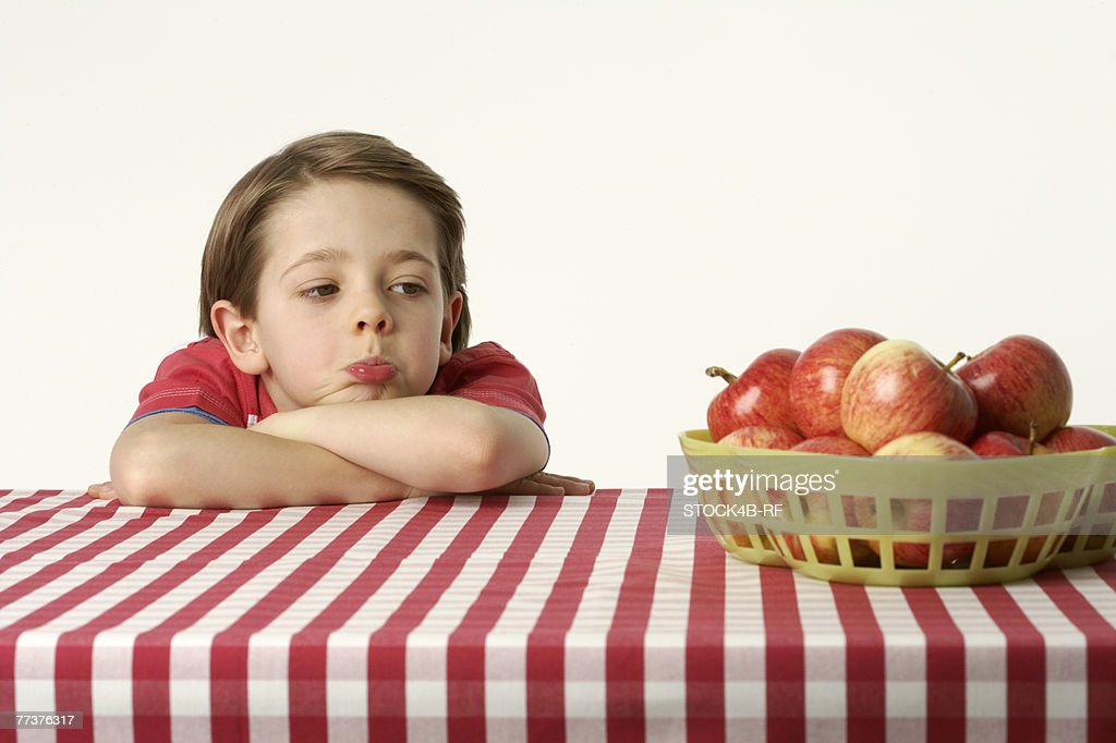 Boy looking at apples : Stock Photo