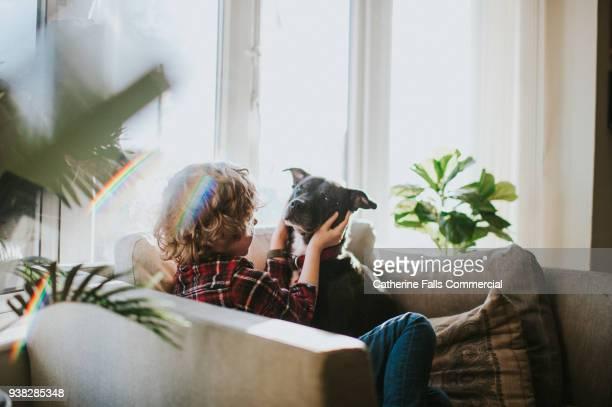 Boy looking at dog
