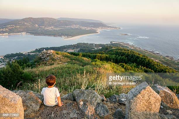 Boy looking at estuary of the Minho River from Mount of Santa Tecla