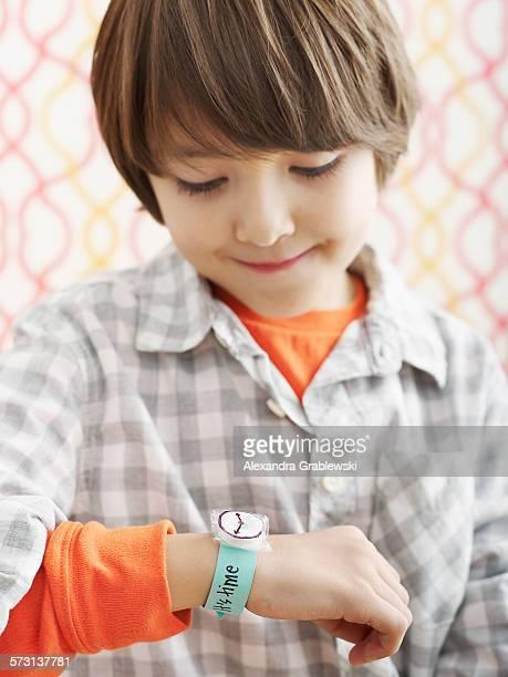 Boy Looking at Fake Watch