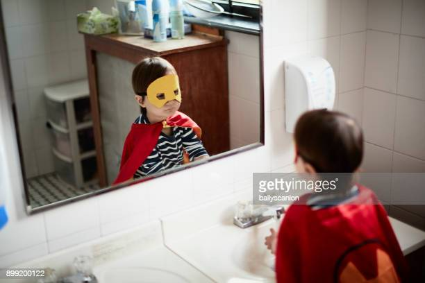 Boy Looking At Himself In A Mirror
