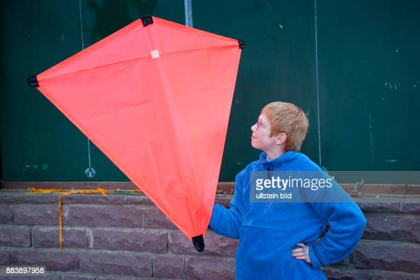 boy looking at his selfmade kite