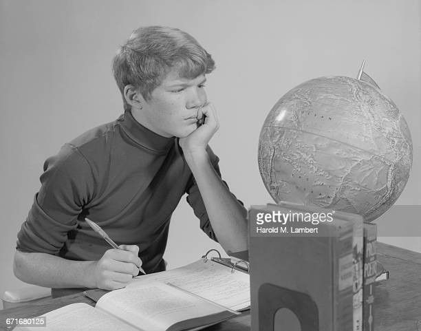 Boy Looking At Map On Globe
