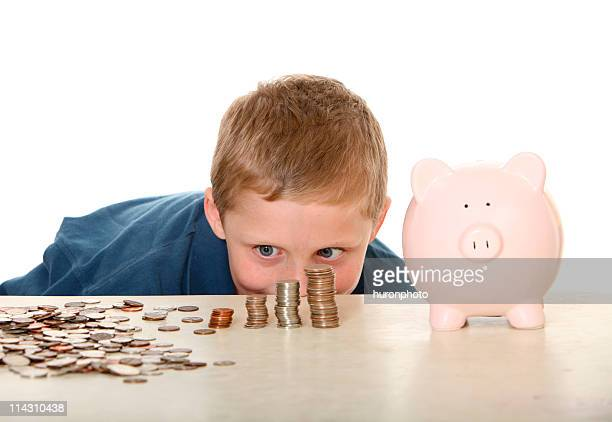 boy looking at money - us coin stock pictures, royalty-free photos & images