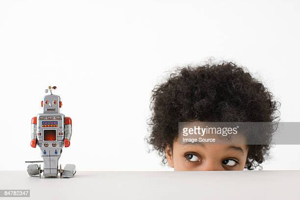 boy looking at robot - peeking stock pictures, royalty-free photos & images