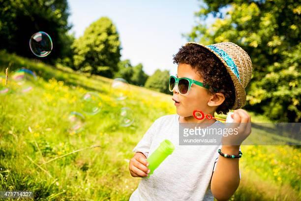 Boy looking at soap bubbles