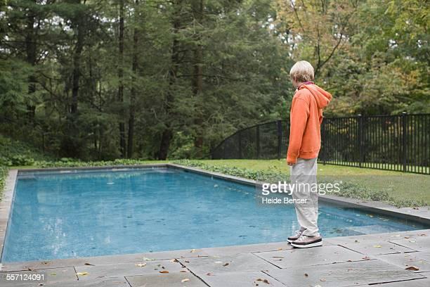 Boy Looking at Swimming Pool