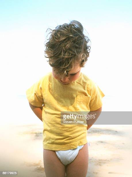 boy looking down - diaper boy stock photos and pictures