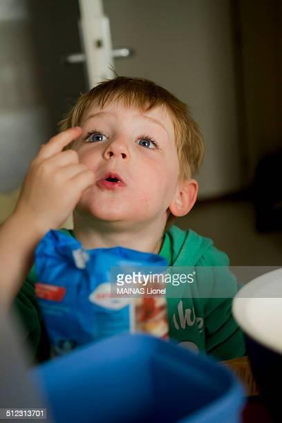 Boy looking fingers