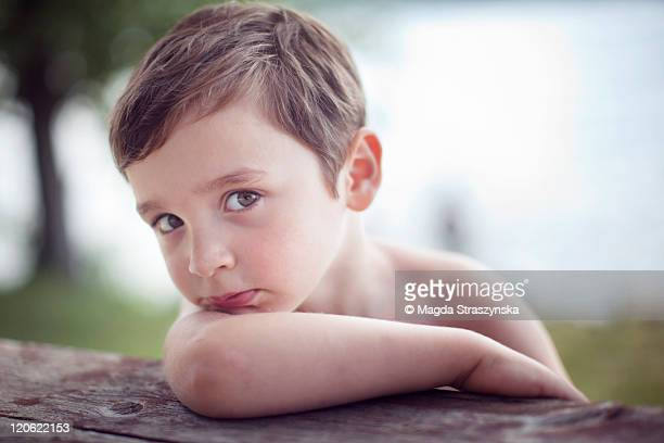 Boy looking from side at picnic table