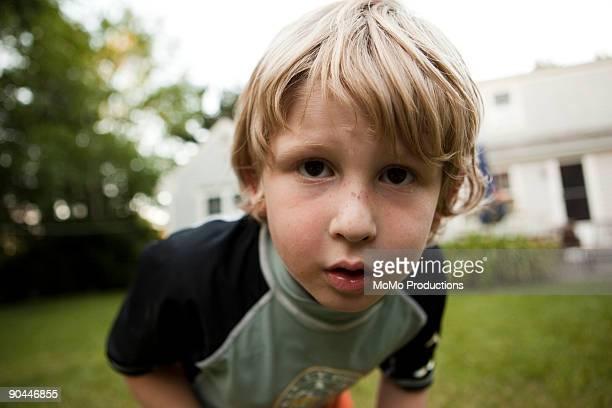 boy (6-7) looking into camera lense