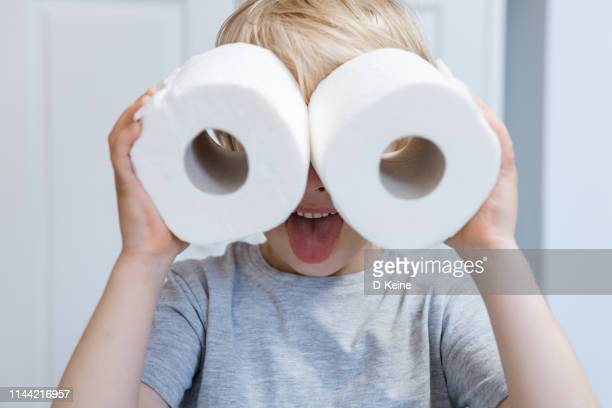 boy looking into improvised binoculars - funny toilet paper stock pictures, royalty-free photos & images