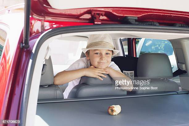 Boy looking out of back seat of car