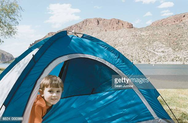 Boy Looking out Tent