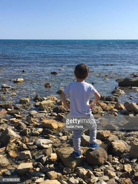 Boy (5 years) looking out to sea at Civitavecchia, Italy