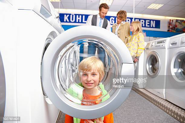 Boy looking through machines' bulls eye
