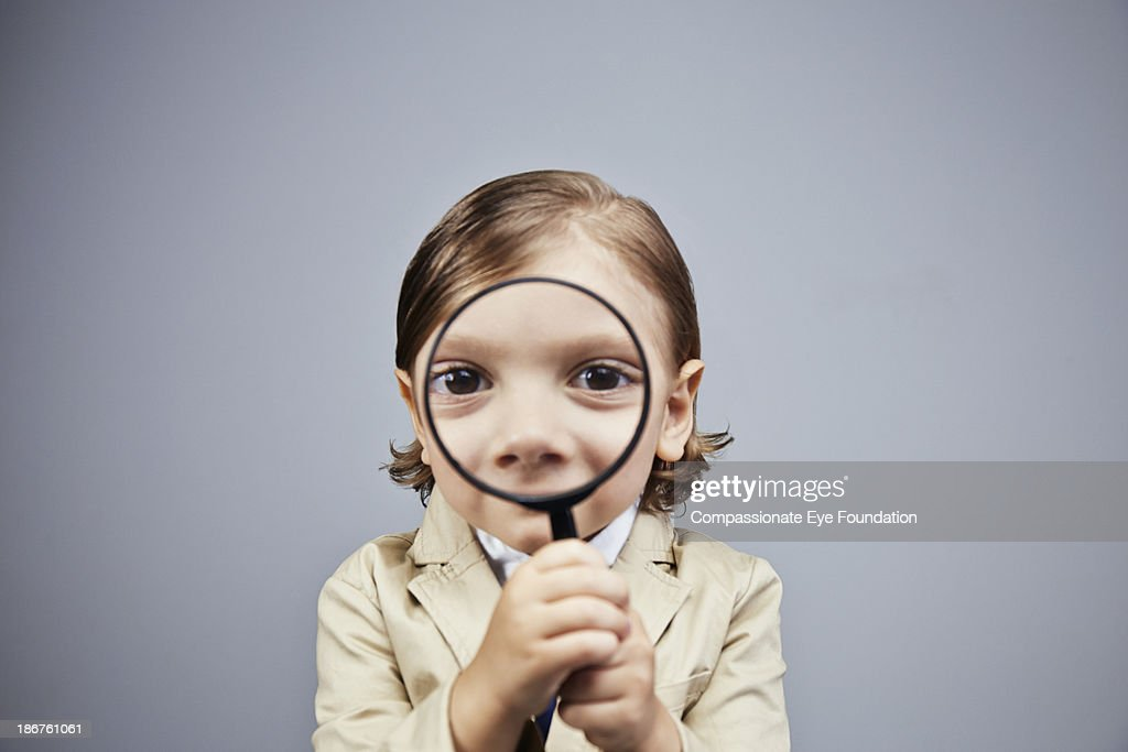 Boy (3-5) looking through magnifying glass : Stock Photo