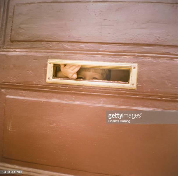 Boy Looking through Mailbox