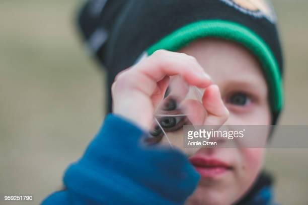Boy looking through prism