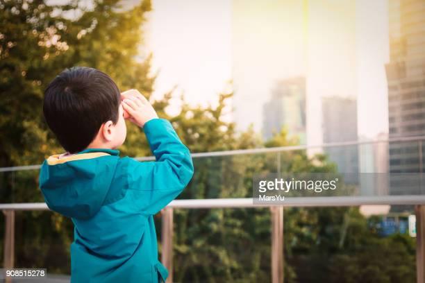 Boy Looking Through Telescope in ShangHai