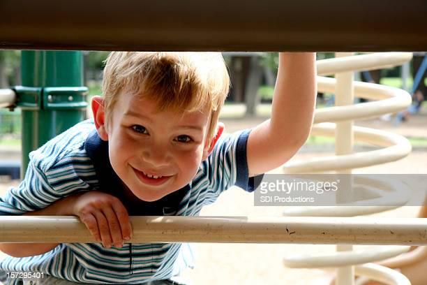 Boy looking under at Outdoor Playground