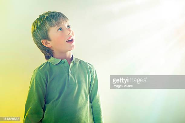Boy looking up at light