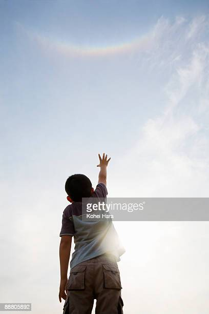 boy looking up at sky