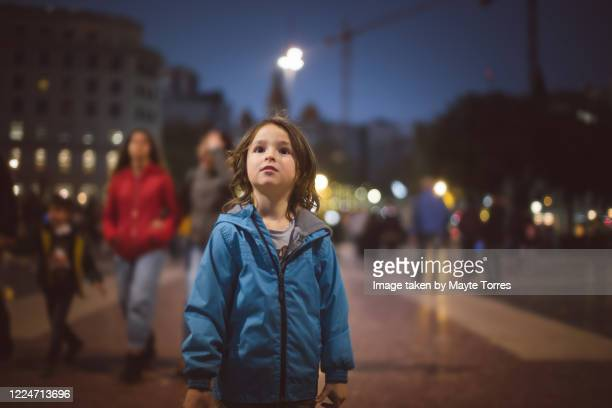 boy looking up in the city - autism stock pictures, royalty-free photos & images