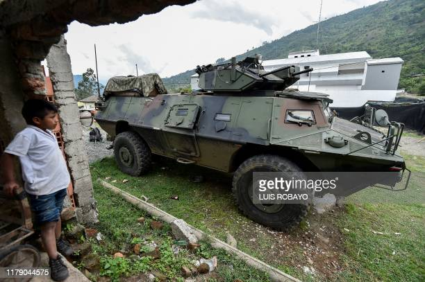 A boy looks at a Colombian Army armoured vehicle in Toribio department of Cauca Colombia on October 30 2019 Five indigenous guards were killed and...
