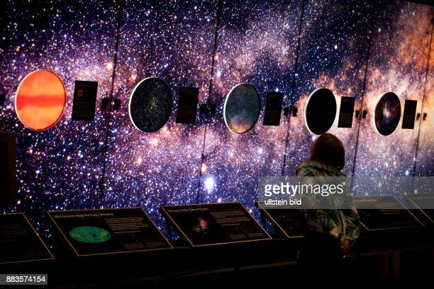A boy looks at a display with the starry sky at the Hall of the Eye exhibition at the Griffith Observatory