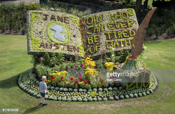 A boy looks at a floral tribute to the author Jane Austen who died 200 years ago today that has been created in the Parade Gardens on July 18 2017 in...
