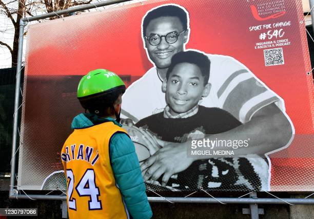 Boy looks at a photo exposition showing a boy Kobe and his father Joe Bryant during the inauguration ceremony of a square named after late Los...