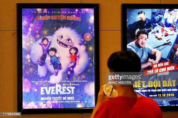 """Boy looks at a poster for the animated movie """"Everest Nguoi Tuyet Be Nho"""", also known as """"Abominable"""", at a movie theatre in Hanoi on October 14,..."""