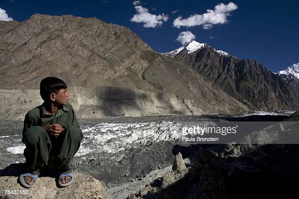 Boy looks at the Hopar glacier on July 6, 2007 in the Central Hunza Region, Northwest Frontier Province, Pakistan. This year is on track to becoming...