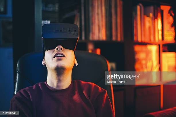 Boy looks fascinated into Virtual Reality Headset