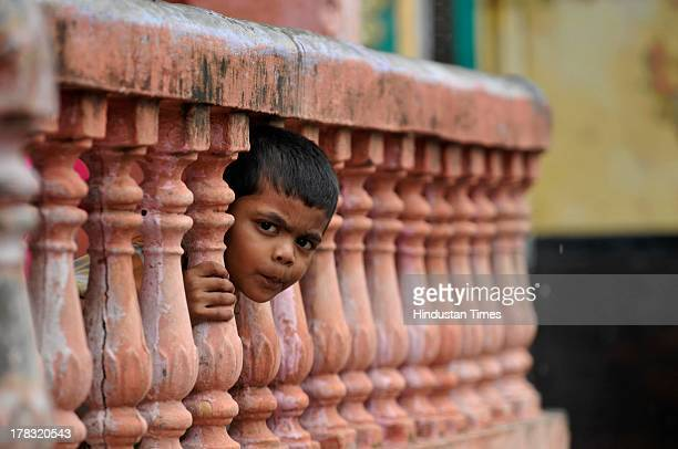Boy looks from his house as high security was on alert in wake of Vishwa Hindu Parishad's 84 Kosi yatra, which was banned by Uttar Pradesh government...