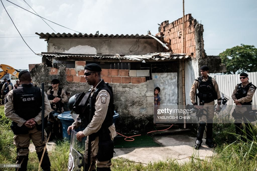 Delightful A Boy Looks From The Front Door Of His House After The House Next Door Was  Demolished, At Rio De Janeirou0027s Vila Autodromo Neighbourhood Near The ...