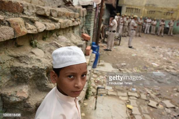 A boy looks on as heavy deployment of police force seen in the backdrop after an eightyearold student of a Madrasa died after he sustained a head...