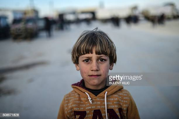 A boy looks on as Syrians fleeing the northern embattled city of Aleppo wait on February 5 2016 in BabAl Salama next to the city of Azaz northern...