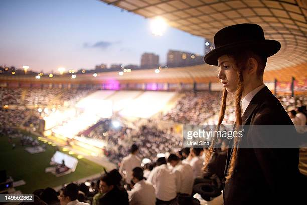 A boy looks on as tens of thousands of Ultra Orthodox Jews attend Siyum HaShas a celebration marking completion of a sevenand a half year daily...