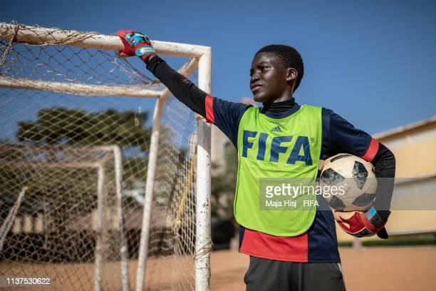 Boy looks on during a FIFA Grassroots schools program on January 16 2019 in Dakar Senegal